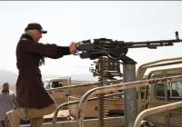 عکس هایی از آزیتا ترکاشوند در پشت تیربار همراه با اسلحه